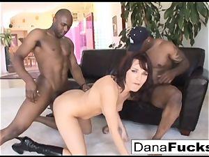 Dana gets her bootie tucked with a massive dark-hued weenies