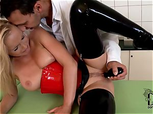 raunchy blond in latex dildoed by the physician