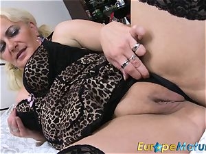 EuropeMaturE blondie doll is frolicking on the sofa
