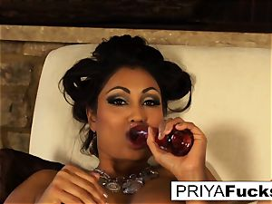 Indian cougar Priya teases then sates her marvelous humid fuckhole