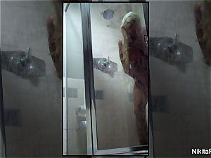 Home movie of Nikita Von James taking a bathroom