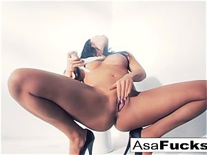 Asa Akira uses a faux arm to satisfy her cooter