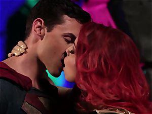 Britney Amber deep-throats off a mischievous superhero